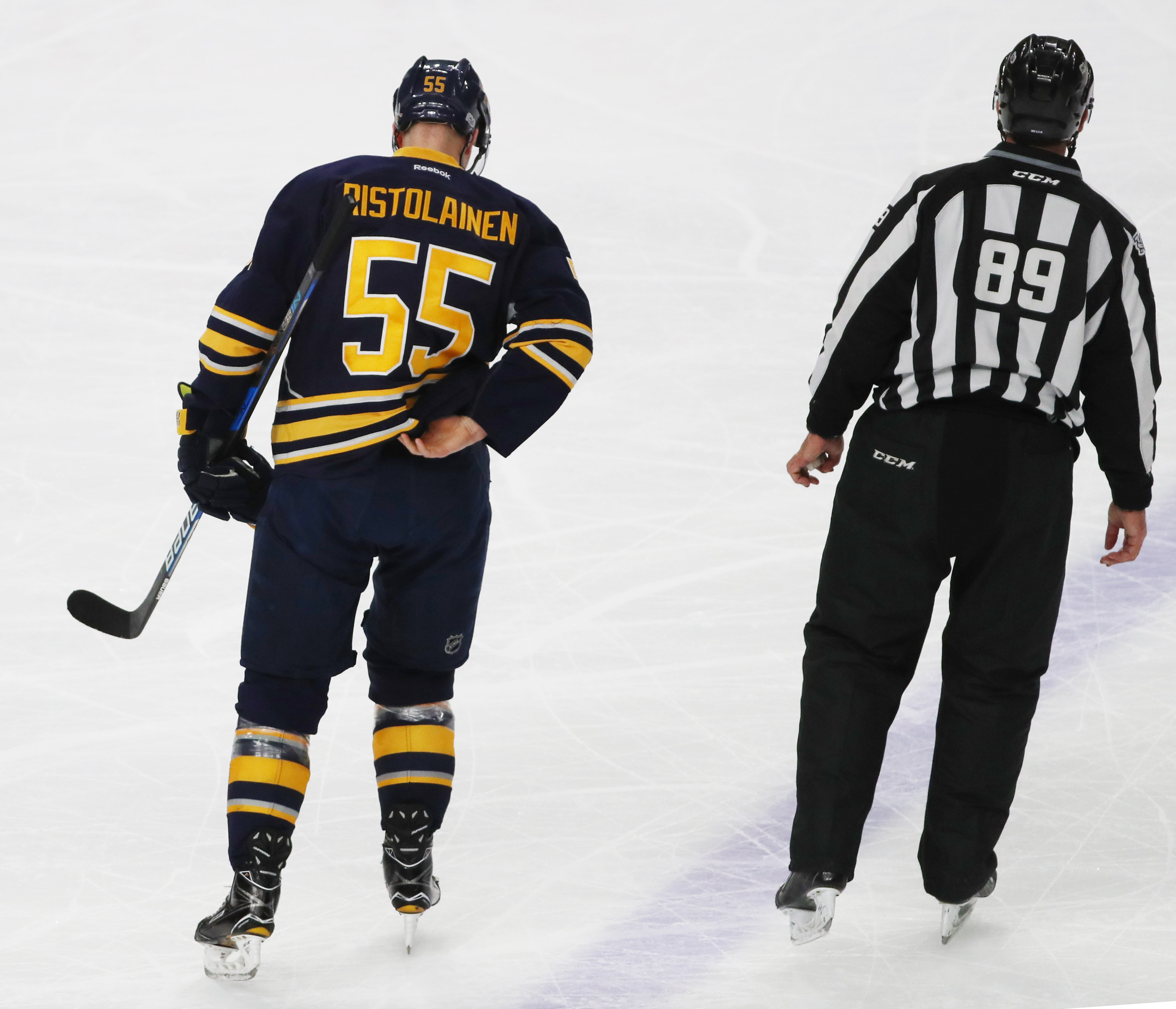 Rasmus Ristolainen is escorted off the ice by an official after getting a game misconduct in Tuesday's loss to Pittsburgh.