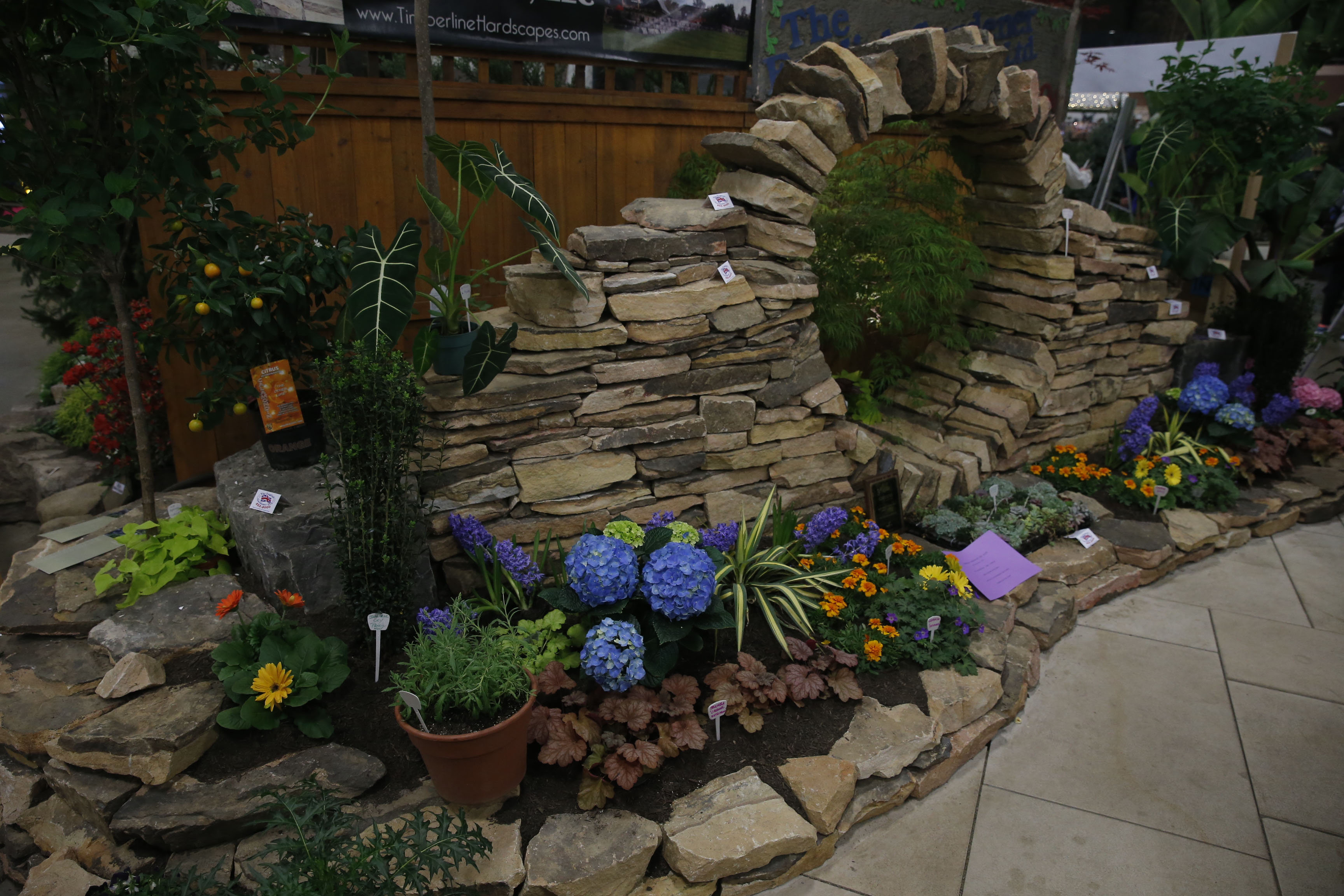 "Seen at the recent Plantasia show in Hamburg: The Keystone Arch, an example of a Roman arch, using stones and wedges with no adhesives. The theme at Plantasia was ""Gardens Through the Ages"". Designers: Todd Fetzer's Timberline LLC and The English Gardeners. (Robert Kirkham/Buffalo News)"