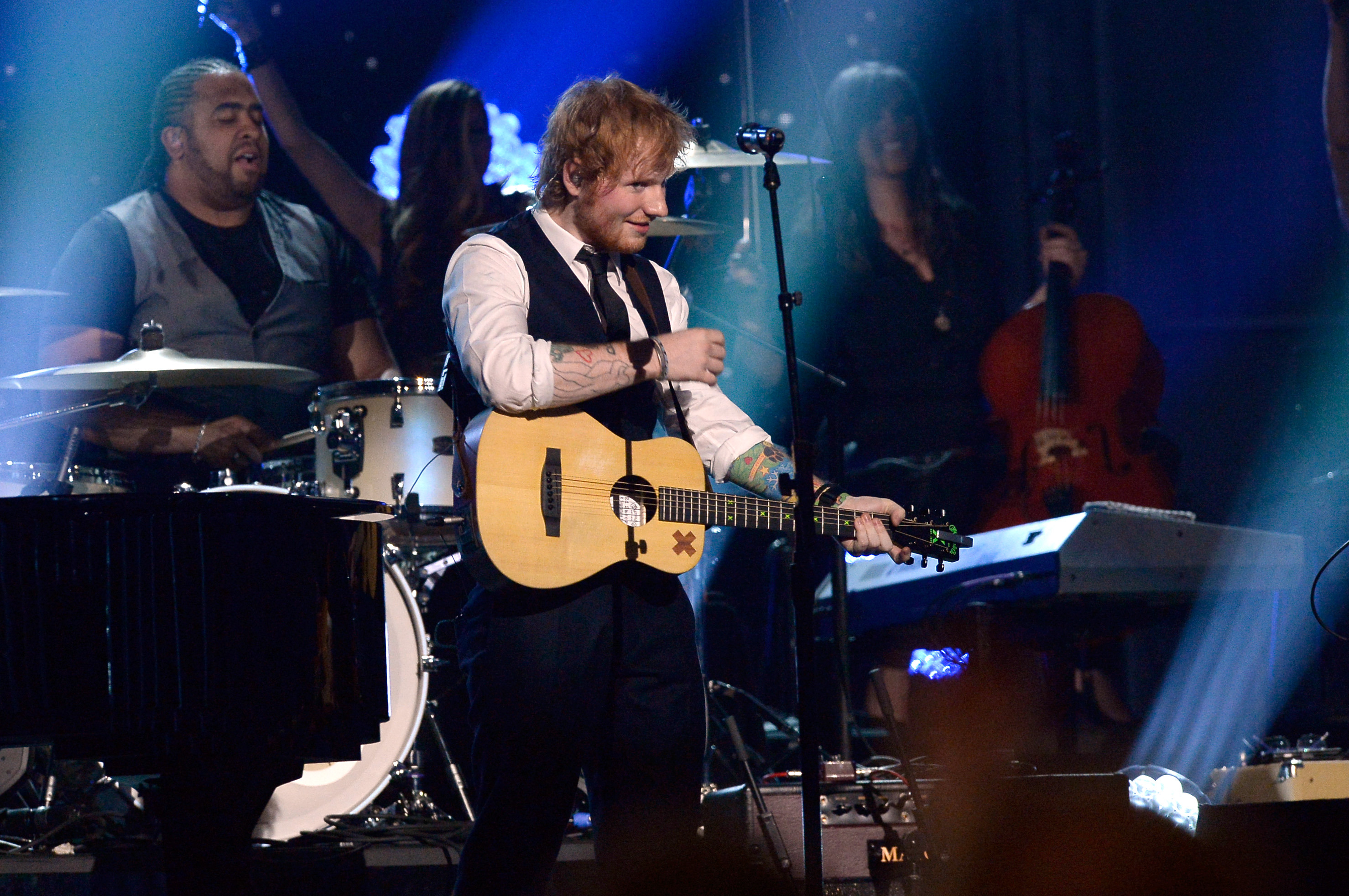 LOS ANGELES, CA - FEBRUARY 08:   Singer Ed Sheeran performs 'Evil Woman/Mr. Blue Sky' onstage during The 57th Annual GRAMMY Awards at the at the STAPLES Center on February 8, 2015 in Los Angeles, California.  (Photo by Kevork Djansezian/Getty Images)