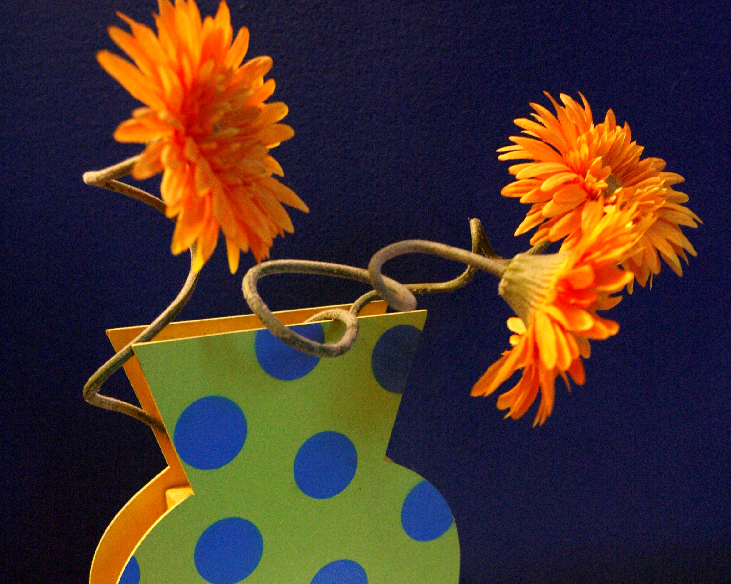 Brighten your decor with a trio of faux blooms artistically arranged in a fun vase. News file photo by Robert Kirkham.