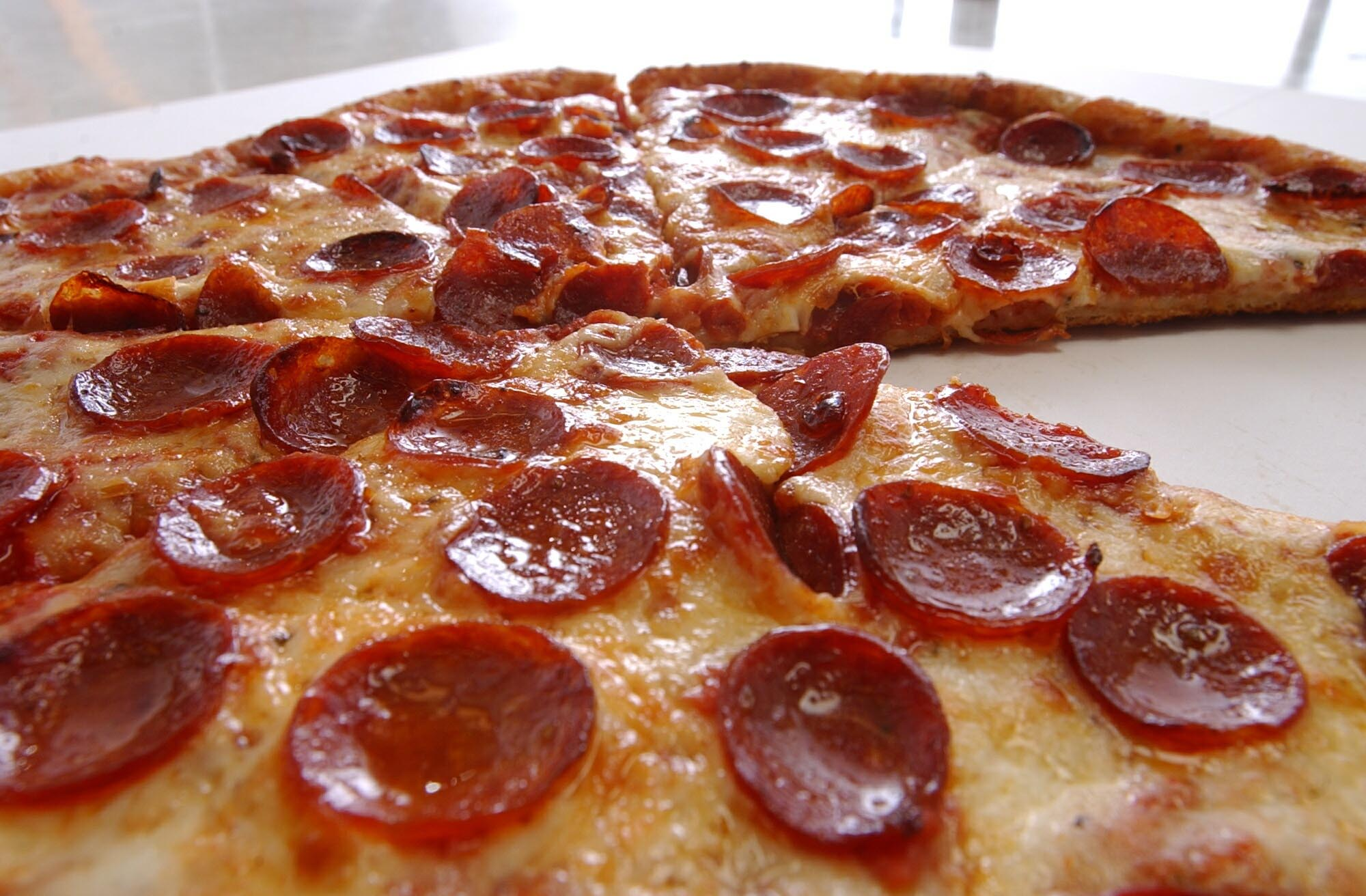 Chip in for pizza and wings with friends at home to save money. (Buffalo News file photo)