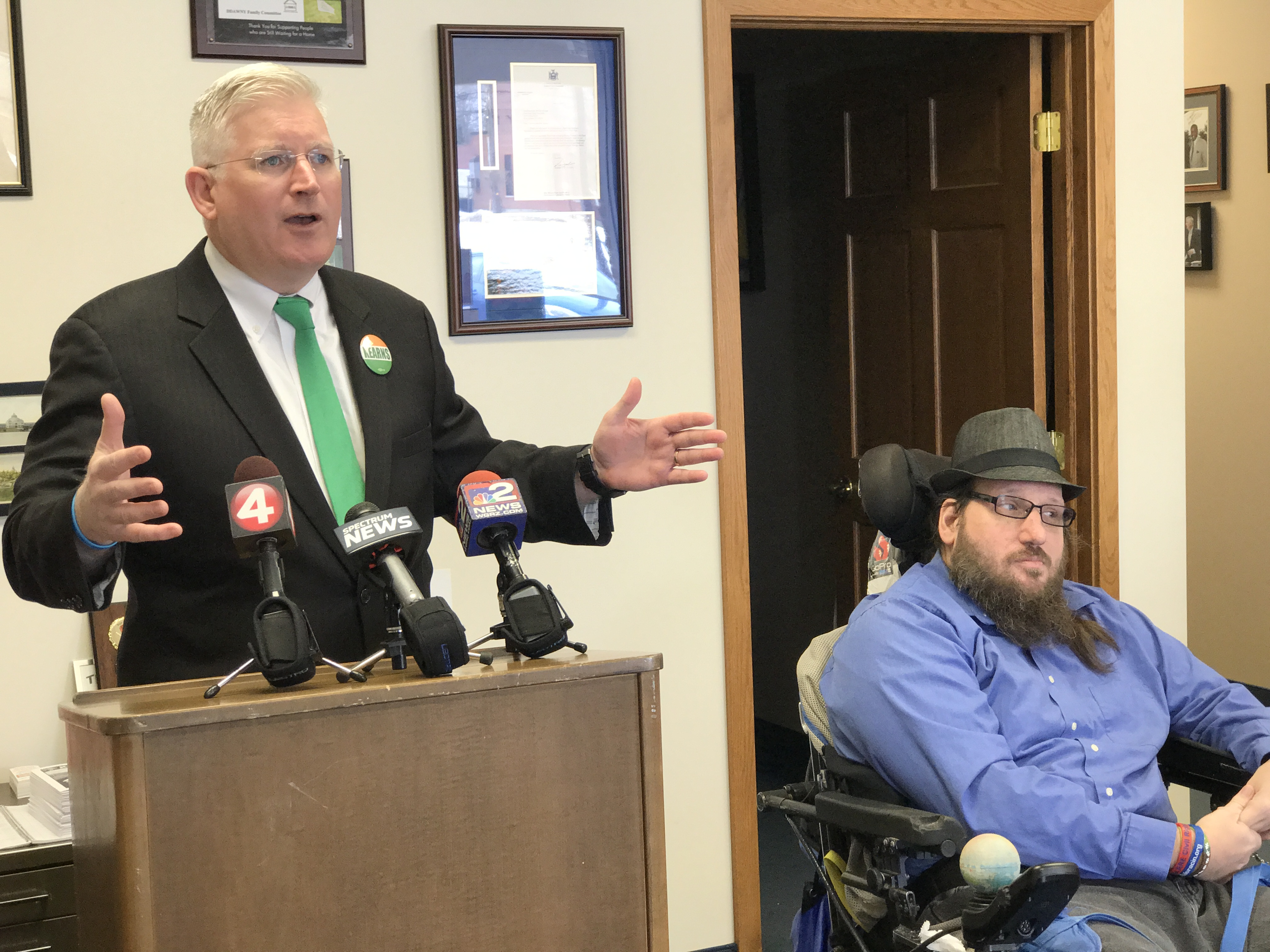 Assemblyman Michael P. Kearns discusses his concerns with NFTA's Paratransit with B.J. Stasio, right, a rider who depends on the service.