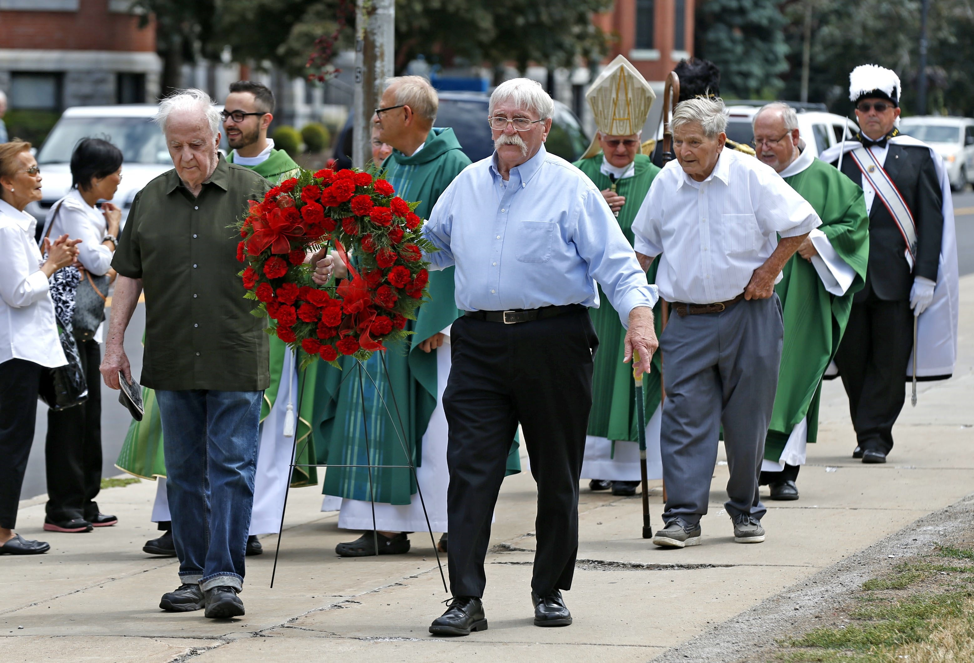 Joe Kelley (left front) took part last summer in a memorial Mass for Father Nelson Baker, at Our Lady of Victory National Shrine and Basilica in Lackawanna. Buffalo's Irish-American community is about to celebrate its first St. Patrick's Day in 88 years without Kelley, who was raised at Father Baker's orphanage and became a Western New York champion of Irish culture. (Robert Kirkham/Buffalo News)