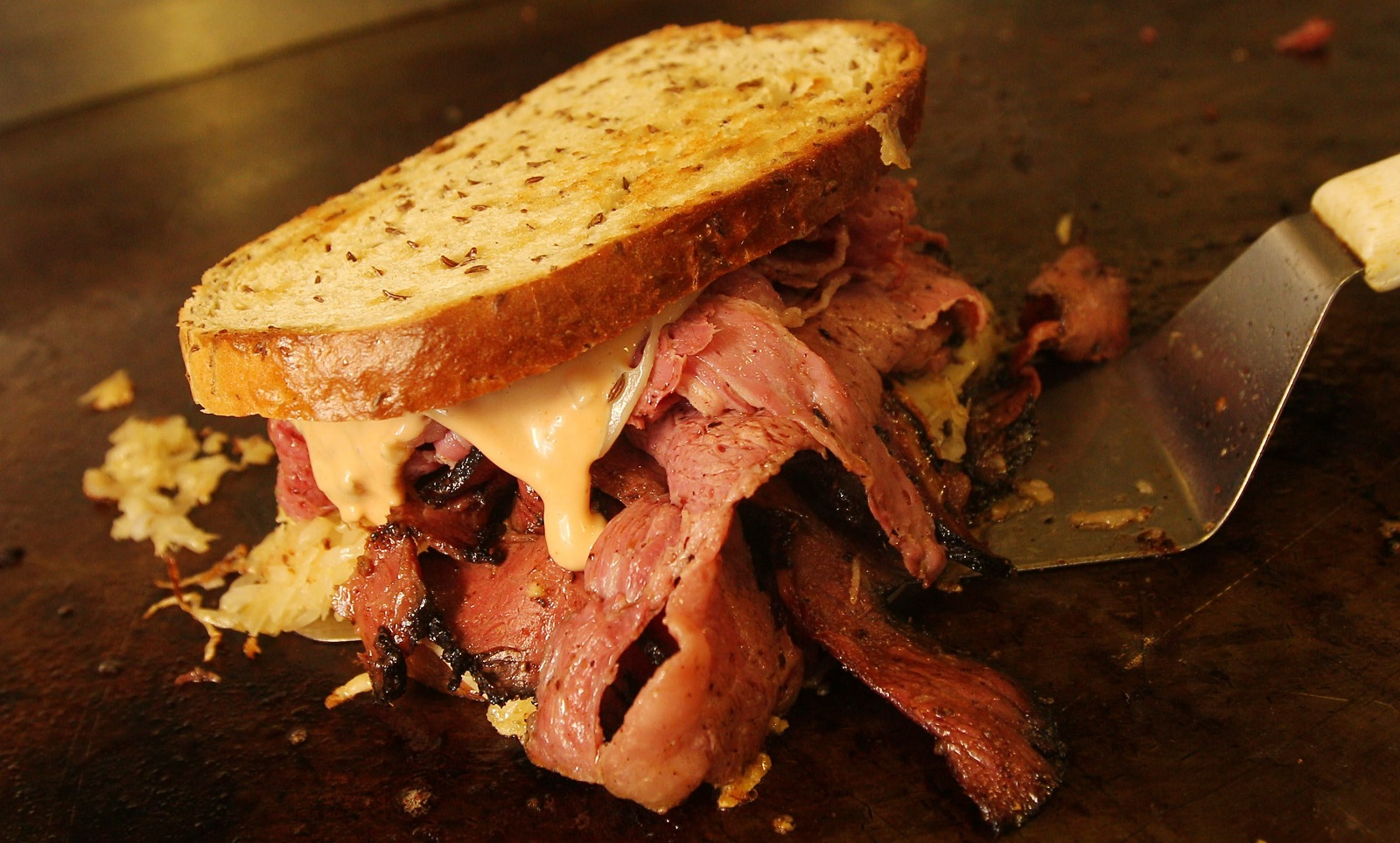 A pastrami corned beef Reuben from Brawlers Back Alley Deli is one treat close by the KeyBank Center. (Sharon Cantillon/Buffalo News file photo)