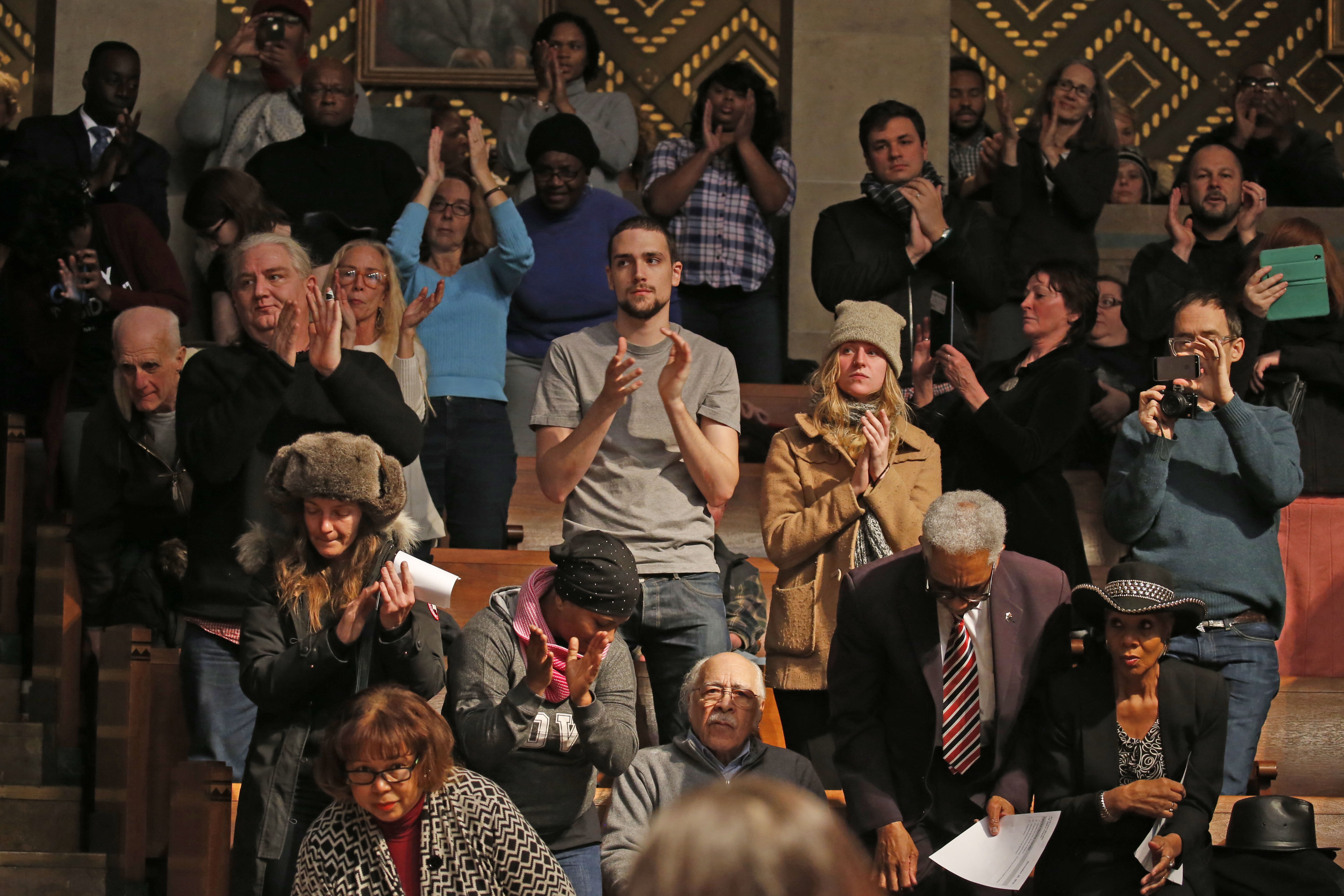 Audience members applaud after the Buffalo School Board requested the resignation of Carl Paladino in the Buffalo City Council chambers  on Thursday, Dec. 29, 2016.  (Robert Kirkham/Buffalo News)