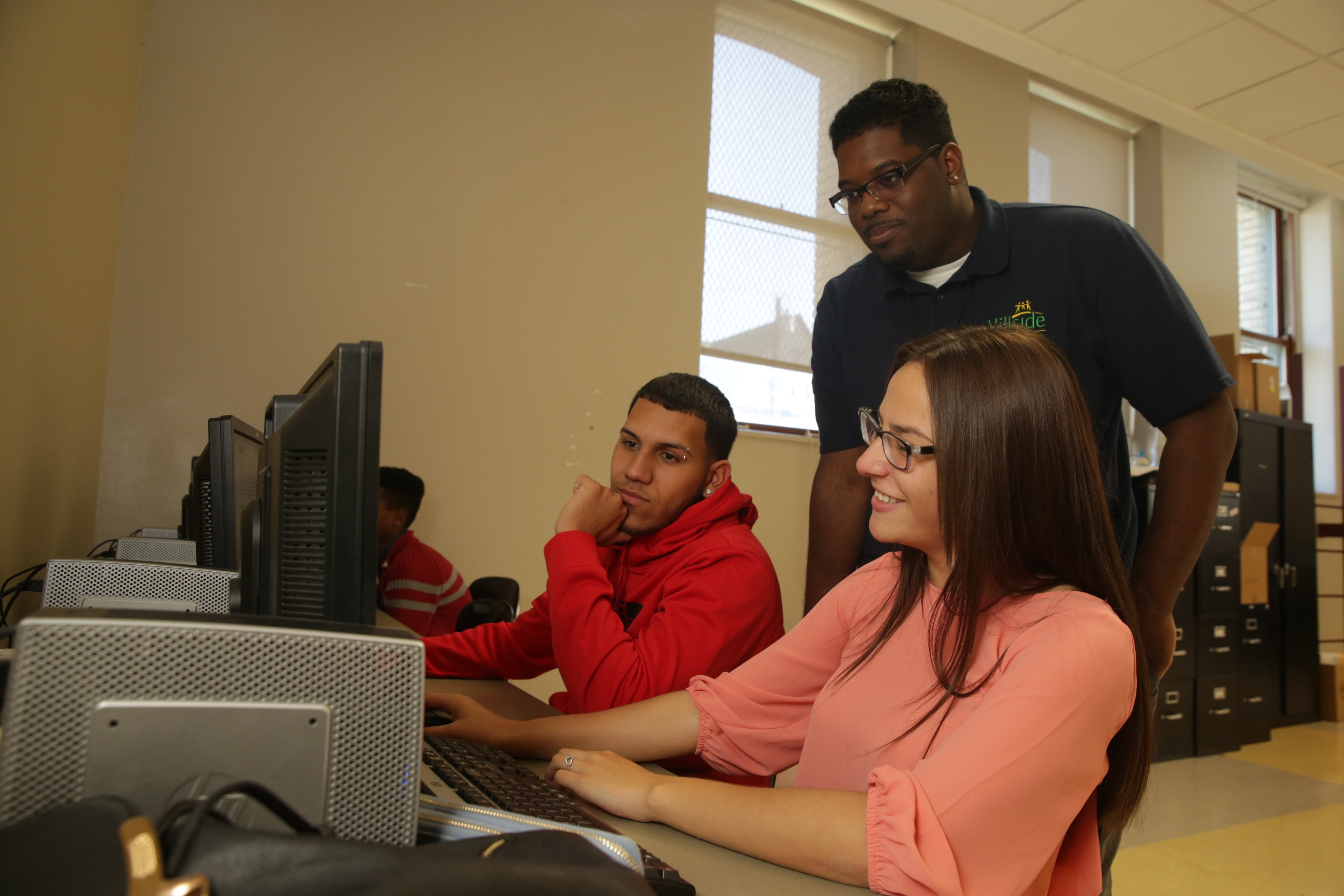 Sterling South, a Hillside Work-Scholarship Connection team advocate, works with Jose Velaezquez, 17, a senior, and Alexanette Vazquez, a junior, at South Park High School in Buffalo, N.Y. in this Oct. 12, 2016 file photo. (John Hickey/Buffalo News)