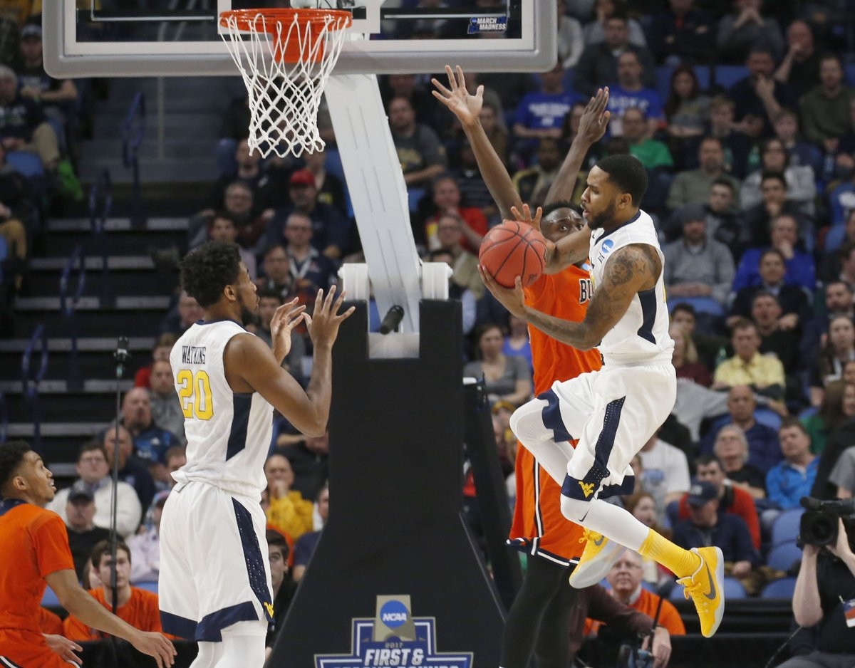 West Virginia gets easy baskets in transition off its press. (Robert Kirkham/Buffalo News)