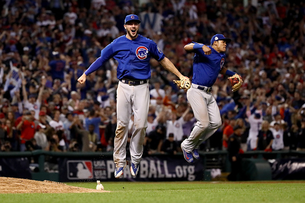 Kris Bryant and Addison Russell celebrate the last out of Game Seven of the World Series in Cleveland. Don't look for a repeat in 2017. (Getty Images)
