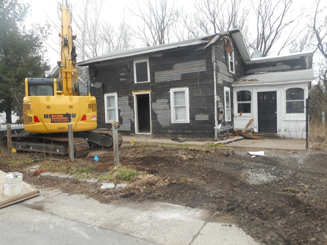 An excavator prepares to tear down a house at 470 Ridge St., Lewiston, on March 28, 2017. (Provided by the Lewiston Council on the Arts)
