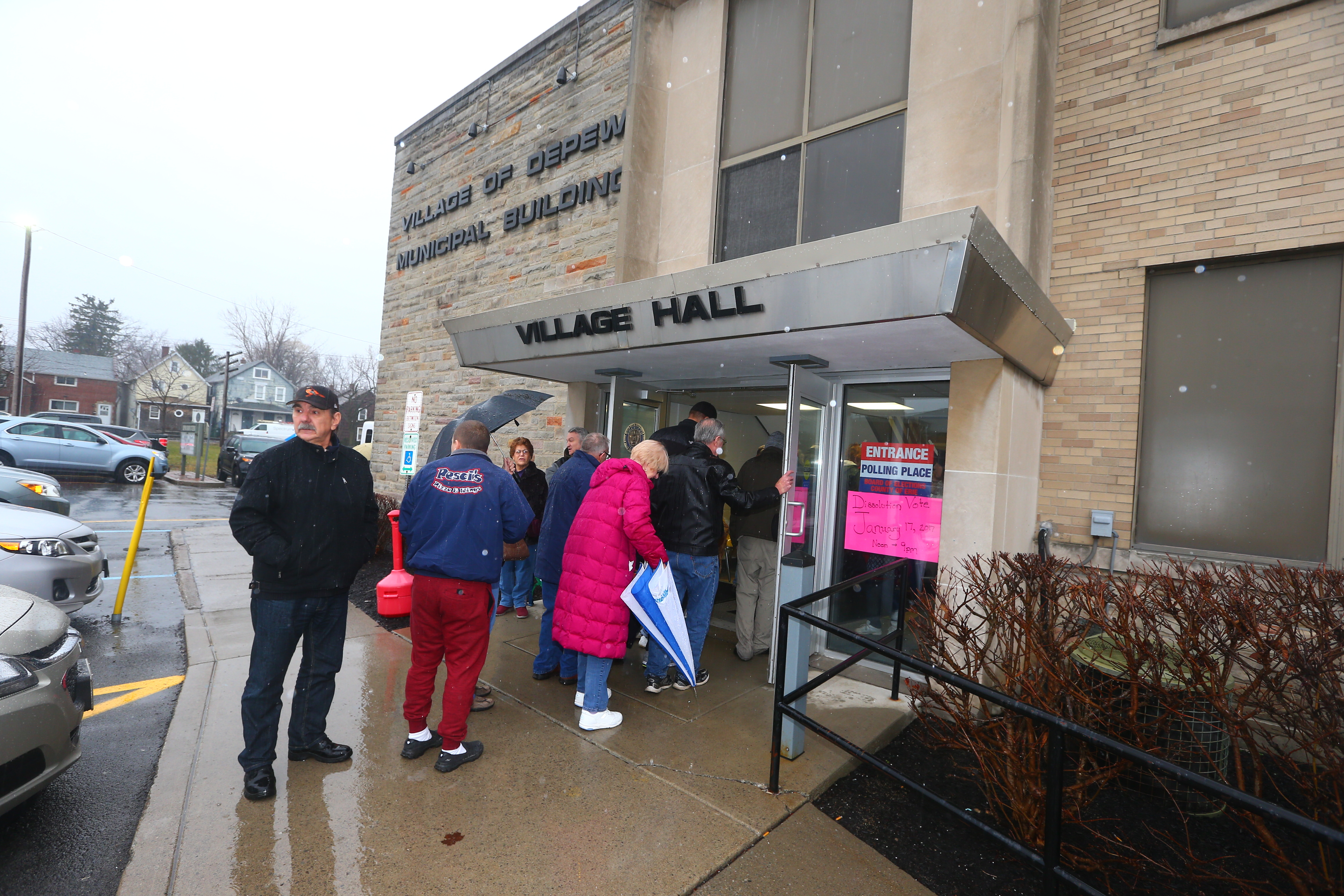 Depew residents line up  outside their Village Hall to vote on whether to dissolve their village government and merge with the towns of Lancaster and Cheektowaga on  Tuesday,  Jan. 17, 2017. (John Hickey/Buffalo News)