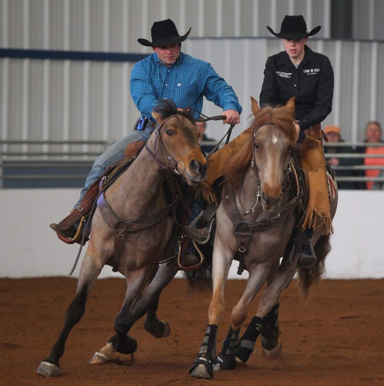 Jack and Emma Minteer do a reined cow horse demonstration during Equifest at the Fairgrounds in Hamburg Saturday, March 19, 2016.   (Mark Mulville/Buffalo News)