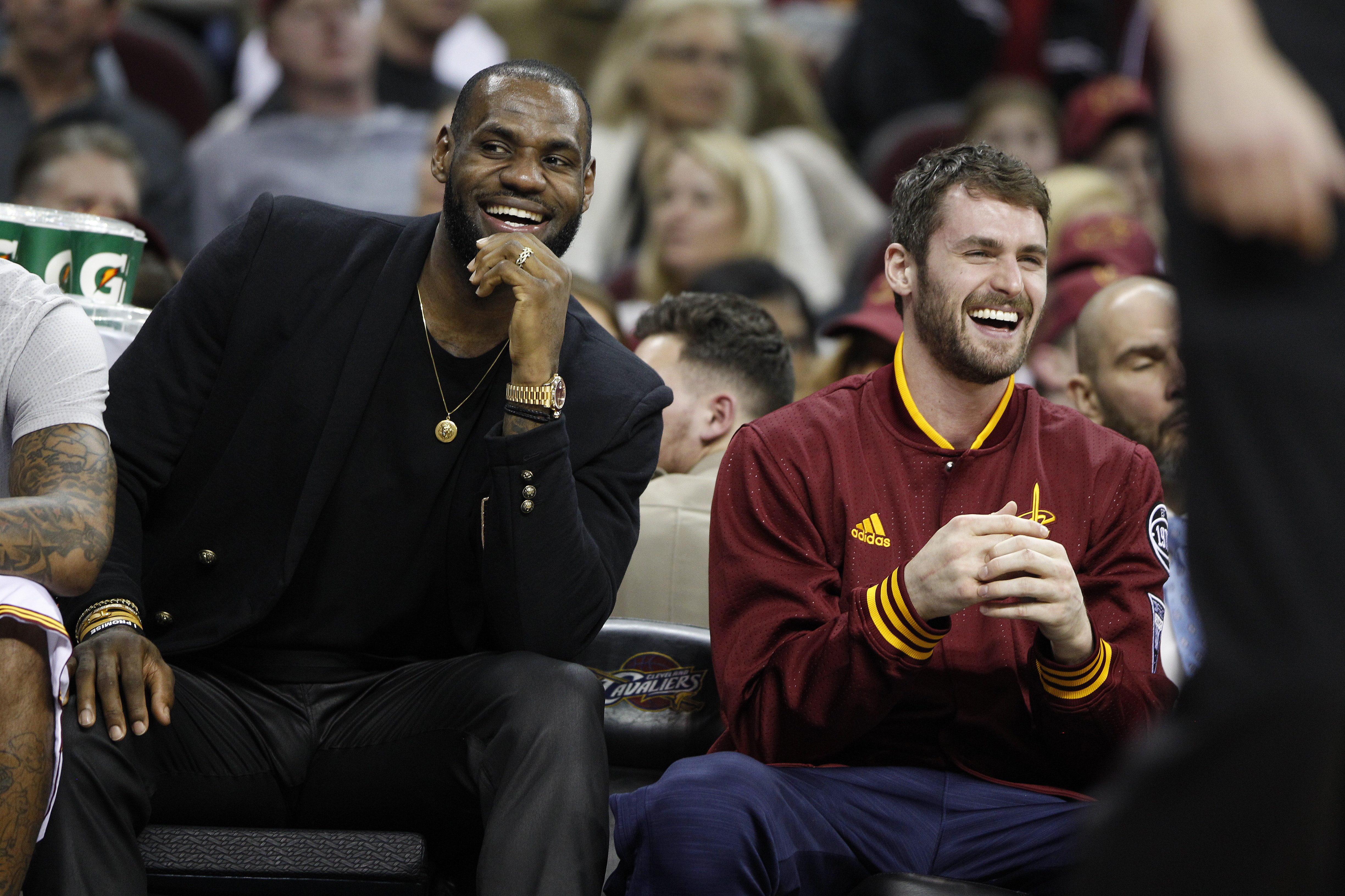Kevin Love (right) and LeBron James of the Cleveland Cavaliers watch from the bench during a loss to Detroit in April 2016. (Getty Images)