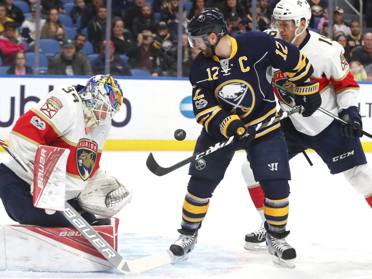 Captain Brian Gionta works the puck against Florida goalie James Reimer during his 1,000th NHL game (James P. McCoy/Buffalo News).