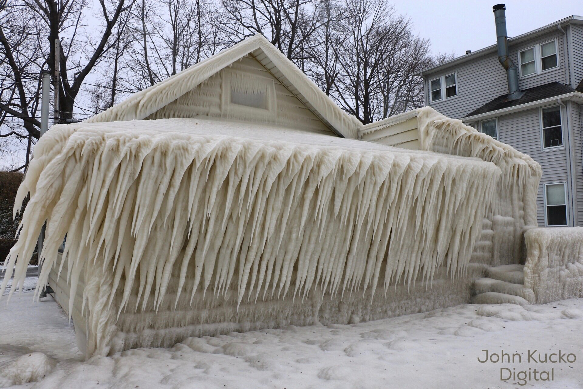 A house on Lake Road, covered in ice, in Webster, NY. (Photo by John Kucko)