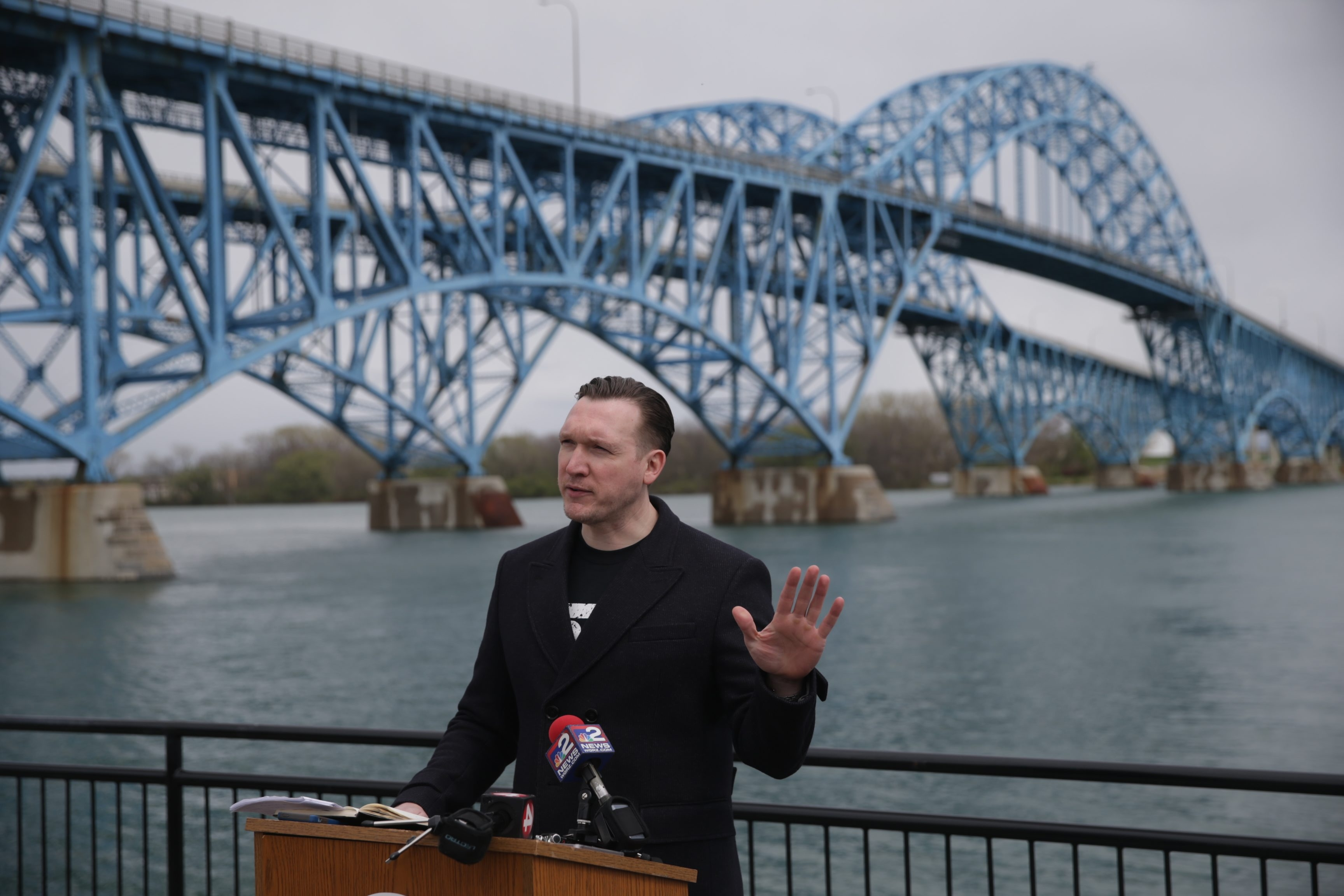 Nathan McMurray speaks at a rally to remove the Grand Island toll barriers at Fisherman's Park. (News file photo)
