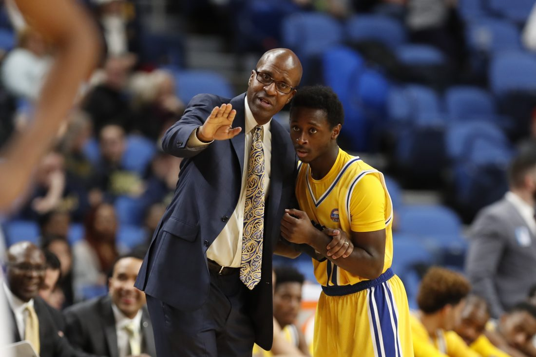 Canisius coach Reggie Witherspoon and Malik Johnson. (Harry Scull Jr./Buffalo News)