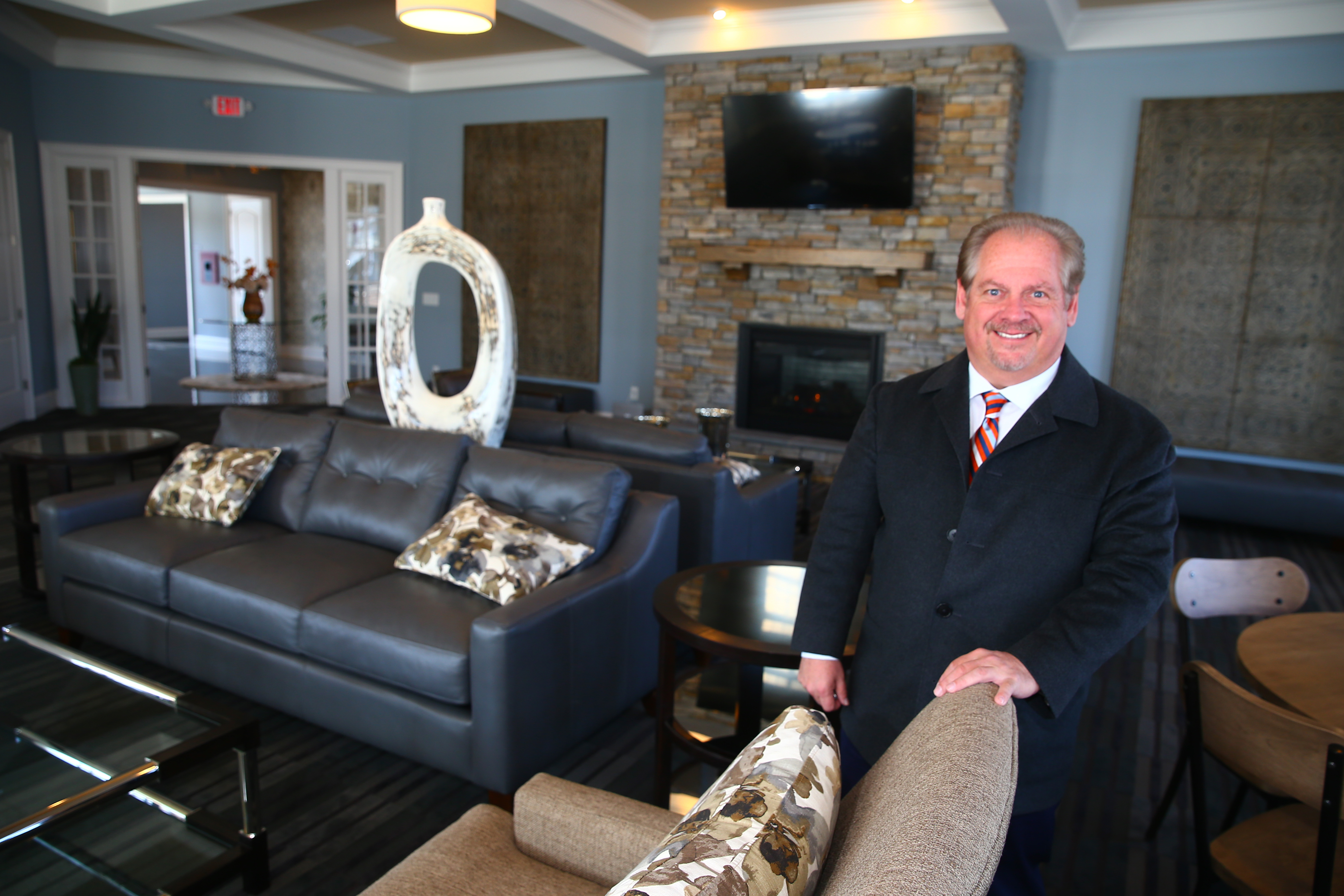 Anthony Cutaia, president of Rane Property Management, shows off the clubhouse at the company's Heron Pointe apartment complex on Grand Island on Thursday,  March 23, 2017. Rane markets many of its Buffalo area apartments and townhomes to millennials. (John Hickey/Buffalo News)
