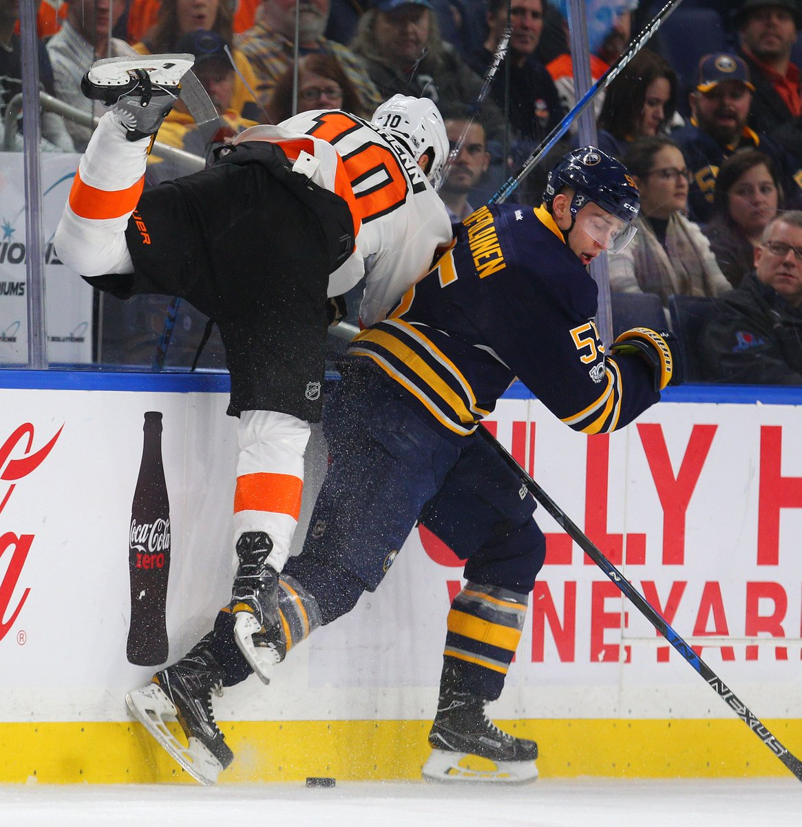 Rasmus Ristolainen battles Brayden Schenn along the boards (Mark Mulville/Buffalo News).