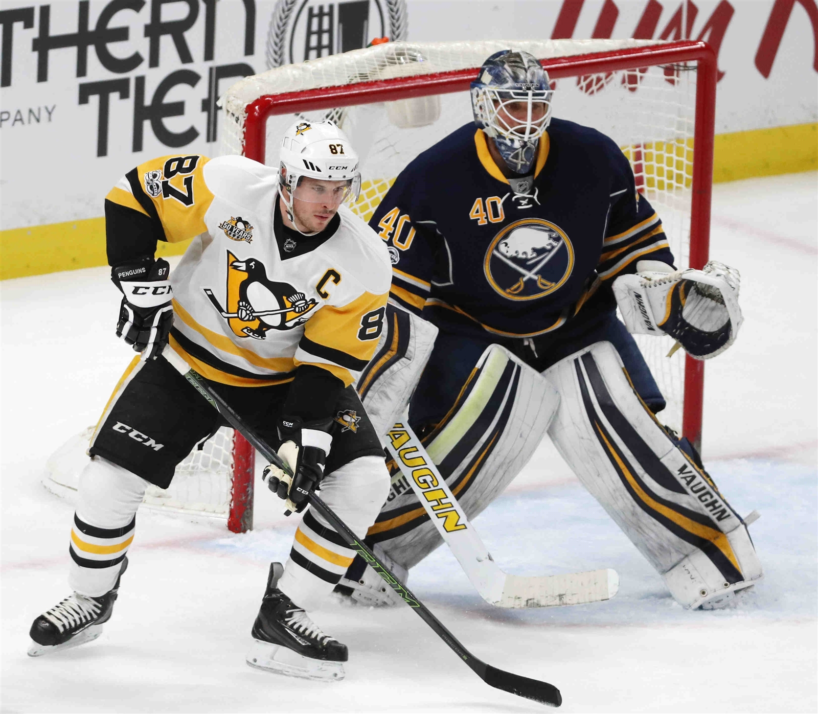 Sidney Crosby works to get position here Tuesday against Sabres goalie Robin Lehner (James P. McCoy/Buffalo News).