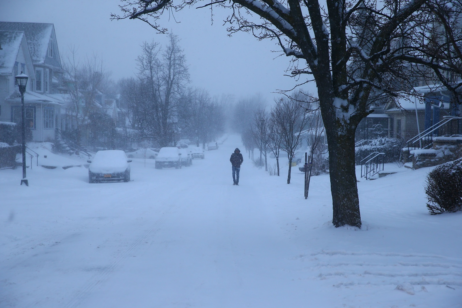 Shanmuga Chilakapati walks on Heath Street to work on Tuesday. (John Hickey/Buffalo News)