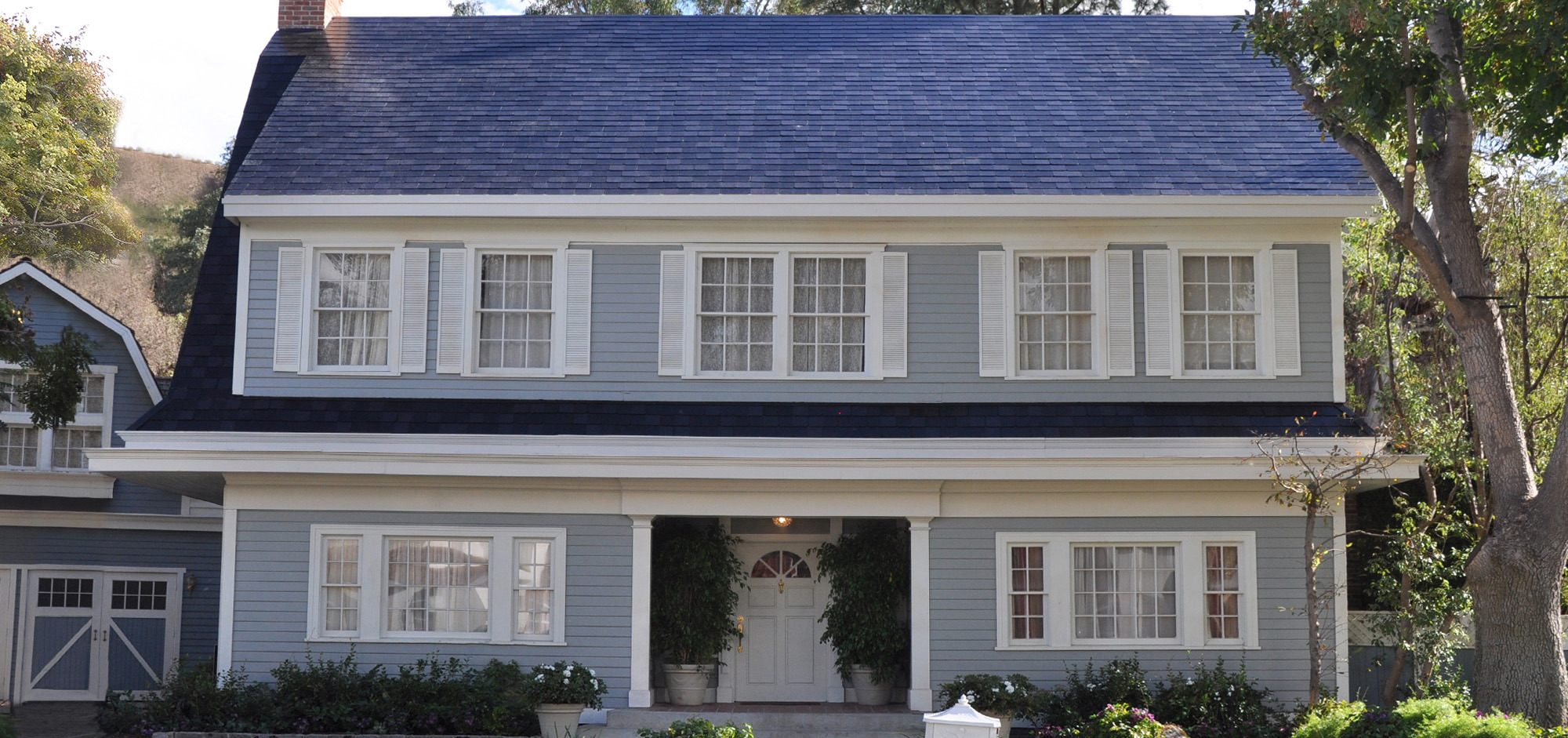 Tesla Inc. plans to start taking orders in April for its solar roof, shown on a home on a Hollywood set during a product unveiling last October. (Photo credit: Tesla Inc.)