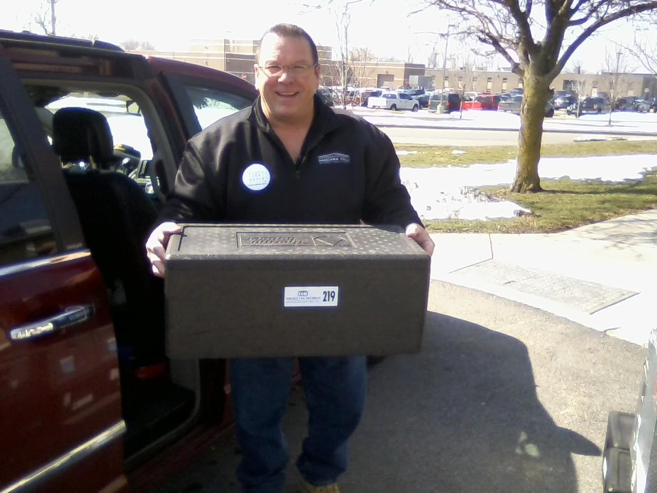 Cheektowaga Deputy Supervisor Tim Meyers delivers shut-ins food from the Meals on Wheels program.  (Provided photo)