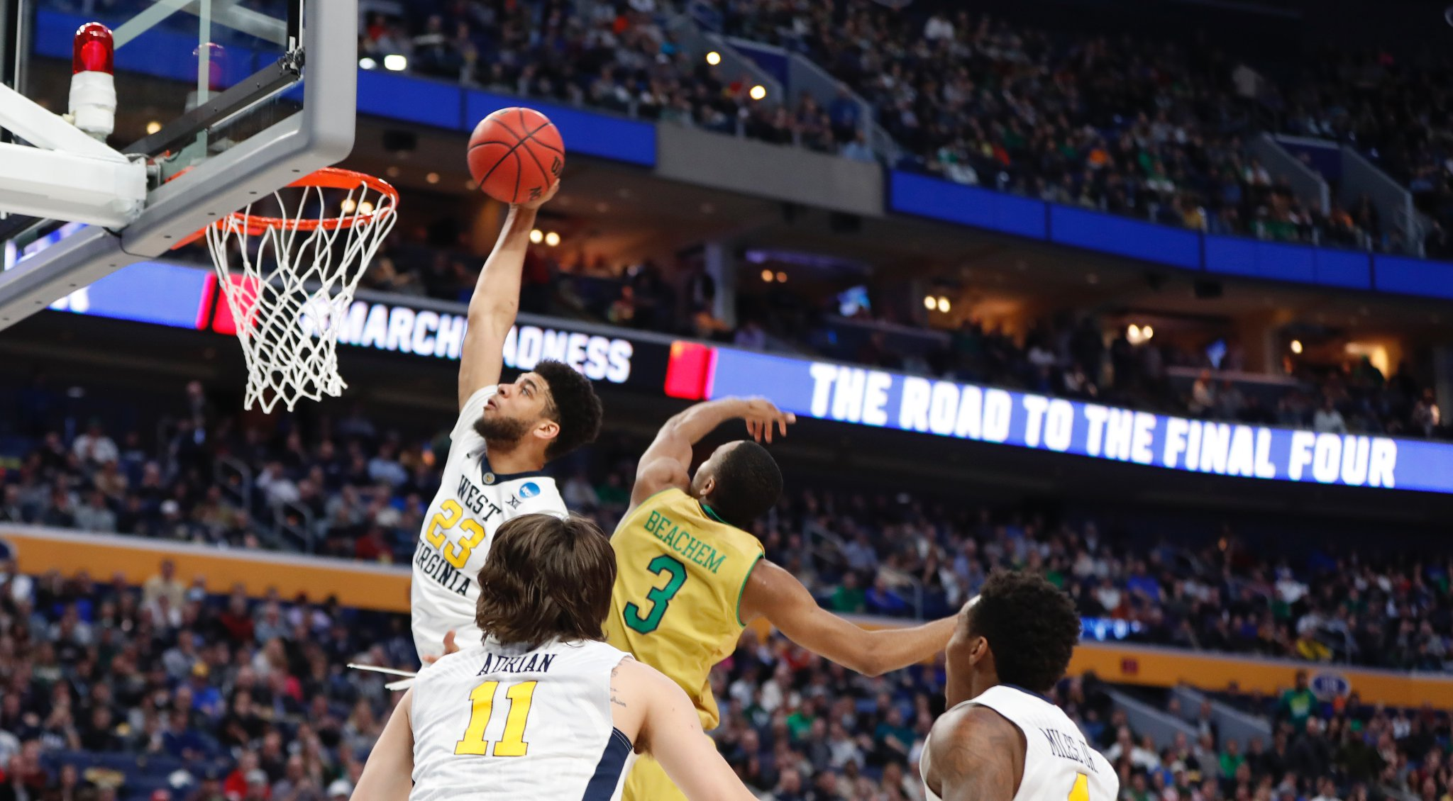 West Virginia's Esa Ahmad flies high for a dunk in win over  Notre Dame. (Harry Scull/Buffalo News)