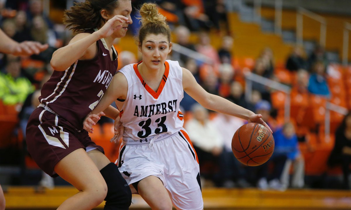 Claire Wanzer of Amherst drives against Pittsford Mendon. (Photo by Harry Scull Jr. / Buffalo News)