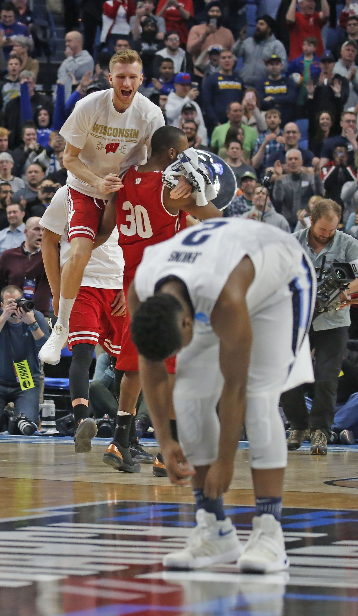 Wisconsin celebrates after beating top-seeded Villanova in the NCAA Tournament (Robert Kirkham/Buffalo News)