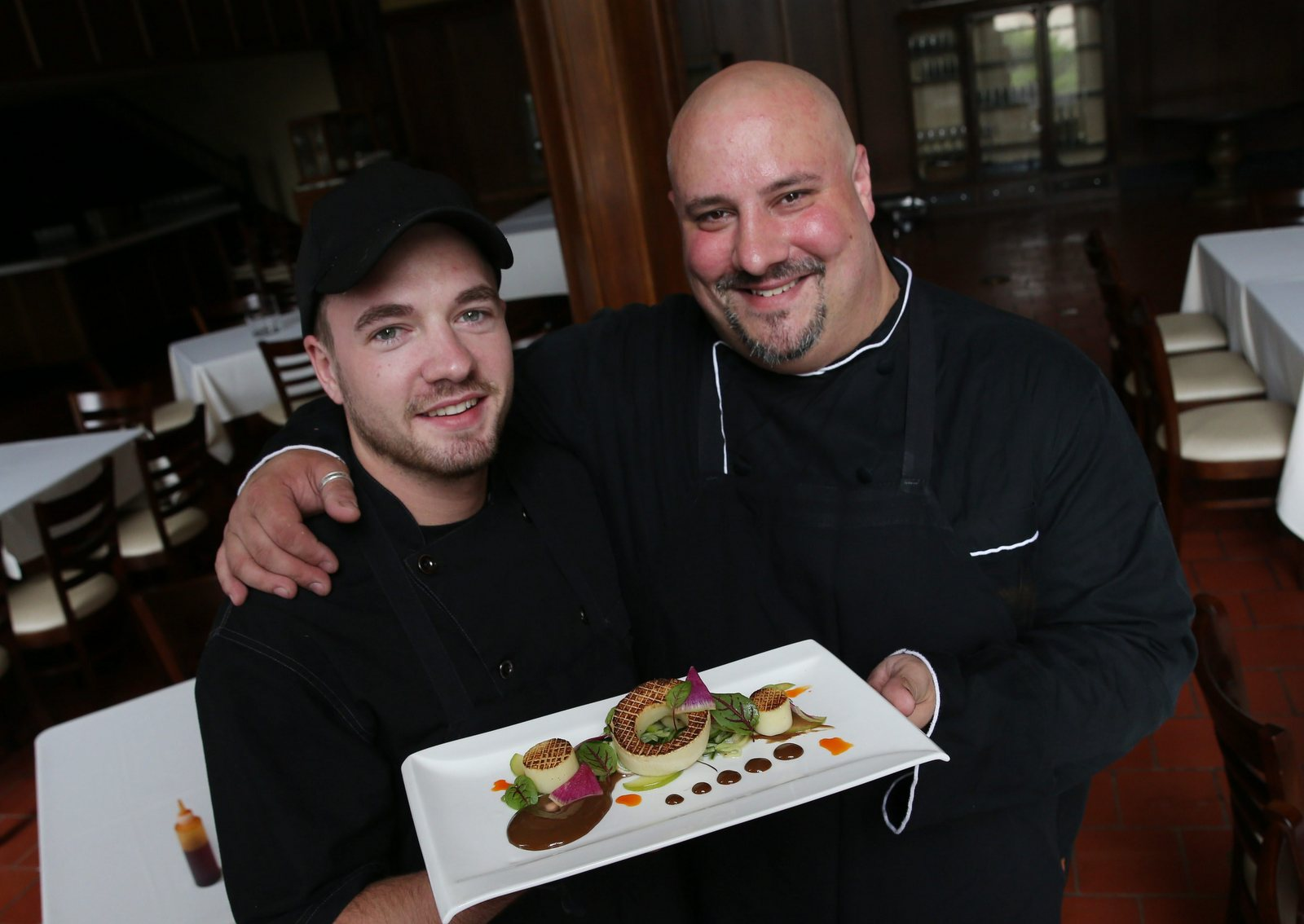 Falley Allen Chef Chris Daigler, right, with Tim Schaedel at Bourbon & Butter.  (Sharon Cantillon/Buffalo News)