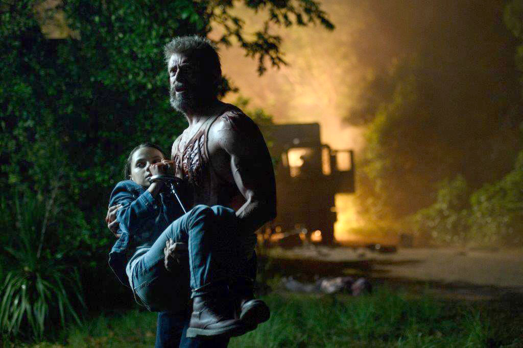 Wolverine (Hugh Jackman) watches over multiple generations, including young Laura (Dafne Keen), in 'Logan.' MUST CREDIT: 20th Century Fox