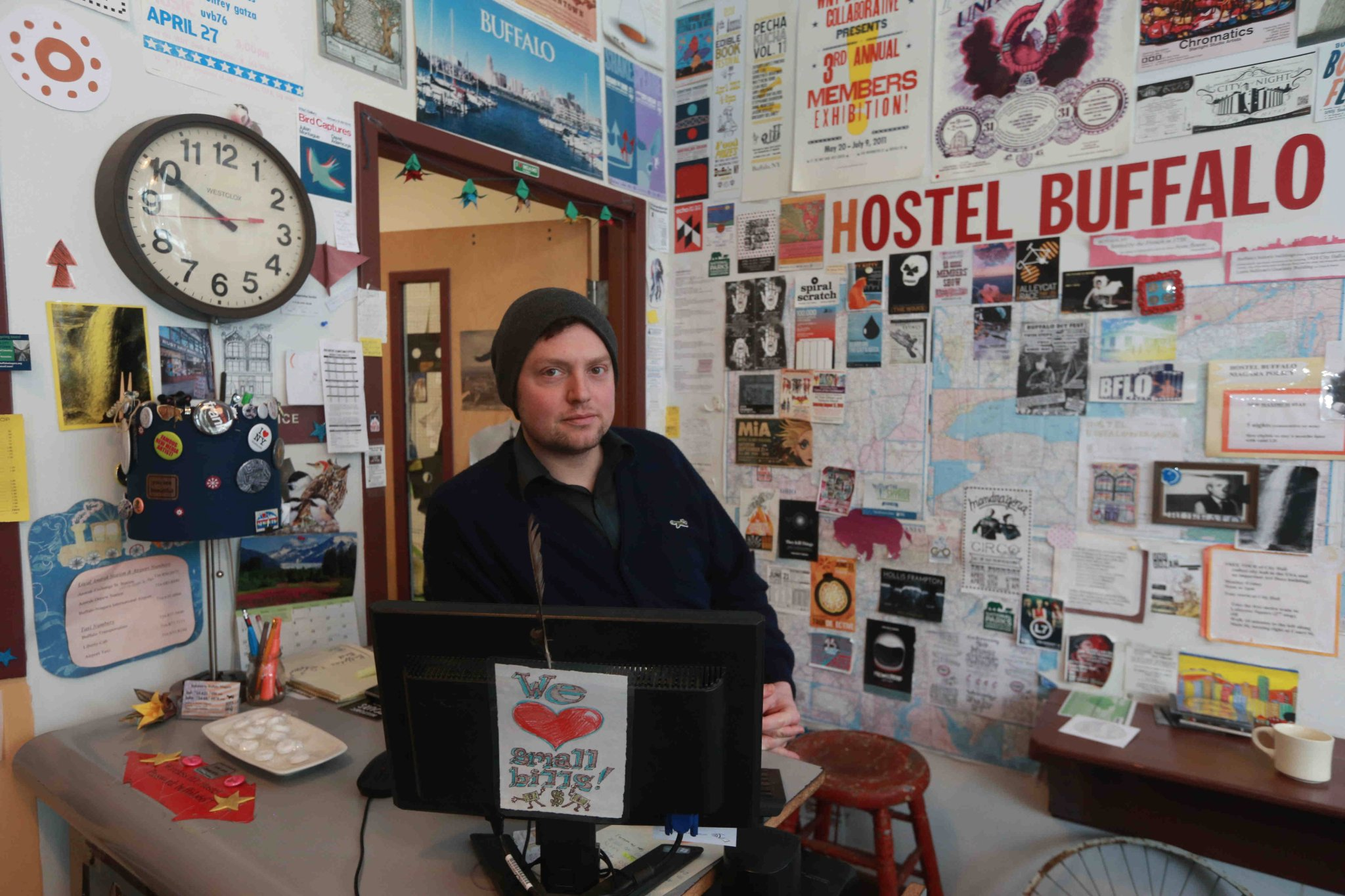 Jonathan Piret, manager at the front desk of the Buffalo Hostel, in Theater District, in Buffalo, N.Y. (John Hickey/Buffalo News)