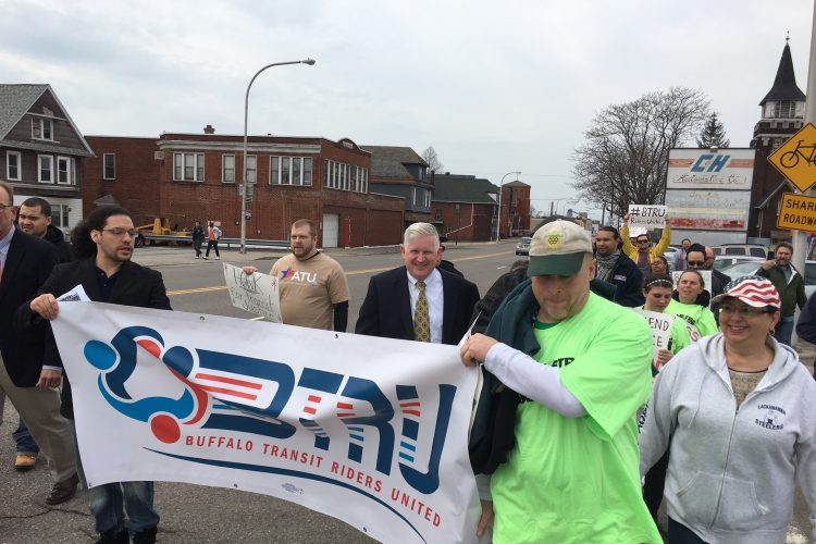 Transit riders air grievances in Lackawanna march to bus stop