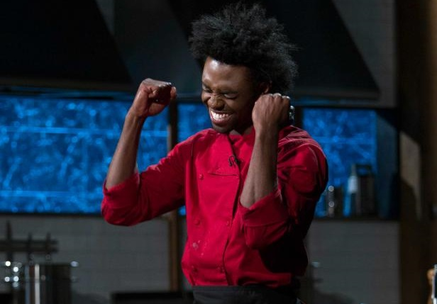 Lazarus Lynch celebrates winning the first round of the Web Stars 'Chopped' competition. (via Food Network)
