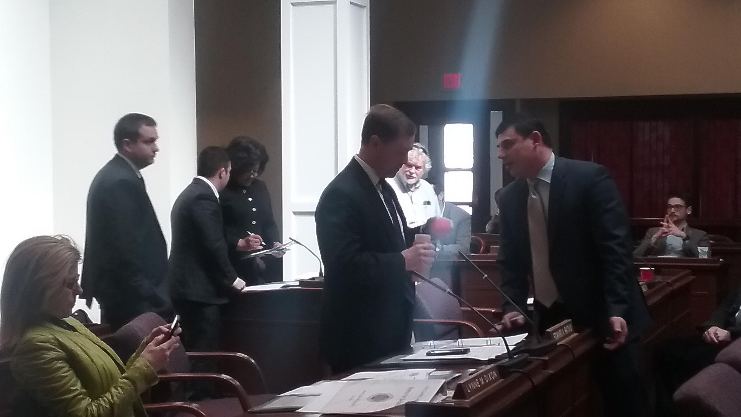 Legislators meet and confer at a recess to discuss amendments to a borrowing deal for ECMC. (Sandra Tan/Buffalo News)