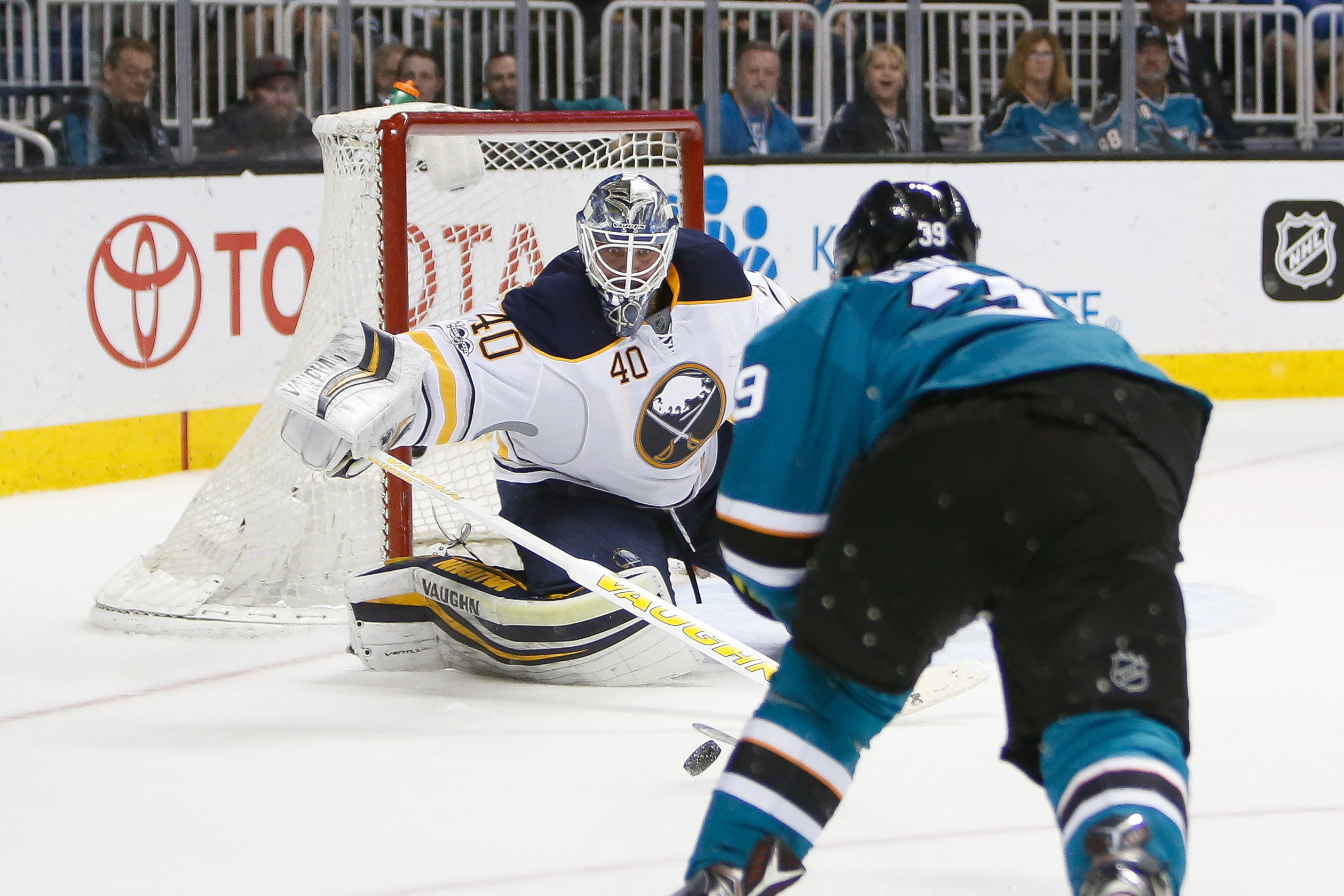 Logan Couture prepares to chip the puck over Robin Lehner for the Sharks' fourth goal (USA Today Sports).