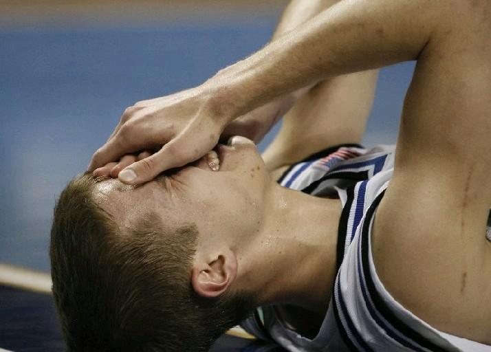 Duke University's Jon Scheyer holds his eye after getting elbowed during the second half of the March 14, 2007, game at then HSBC Arena in Buffalo. (Mark Mulville/Buffalo News)