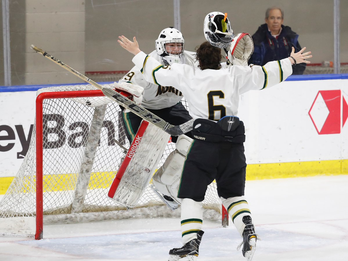 Matt Bielinski and goalie Jake Zurat start the celebration after Williamsville North captured the state Division I hockey title with a 3-2 victory over Pittsford. (Harry Scull Jr./Buffalo News)