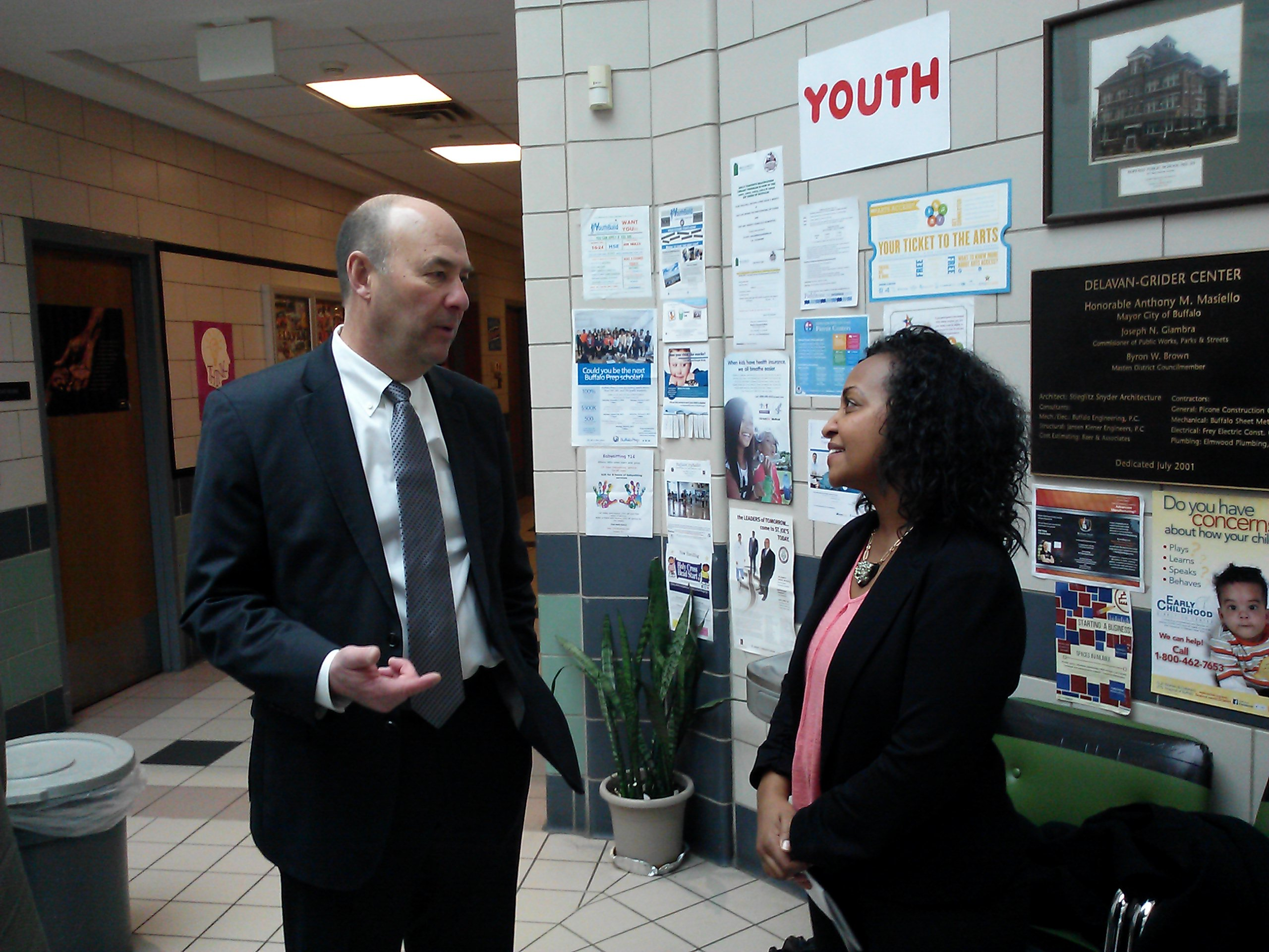 Northwest Bank chairman, pres. and CEO William Wagner talks with Rahwa Ghirmatzion, deputy director of PUSH Buffalo.
