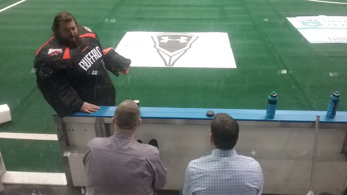 Goalie Dave DiRuscio has a pregame chat with Bandits GM Steve Dietrich and assistant coach John Tavares.