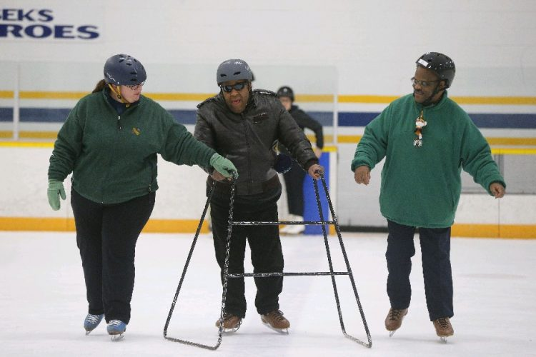 SABAH skaters Davis Tyler, center, and Paris Adams, right, work with Carrie Drabik during practice at the Riverside Rink in Buffalo. (Mark Mulville/Buffalo News)