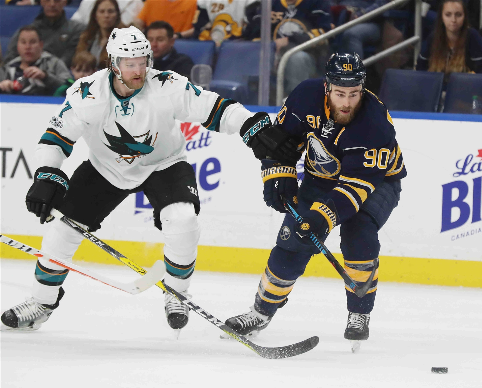 Ryan O'Reilly and Paul Martin battle for the puck last month in KeyBank Center (James P. McCoy/Buffalo News).