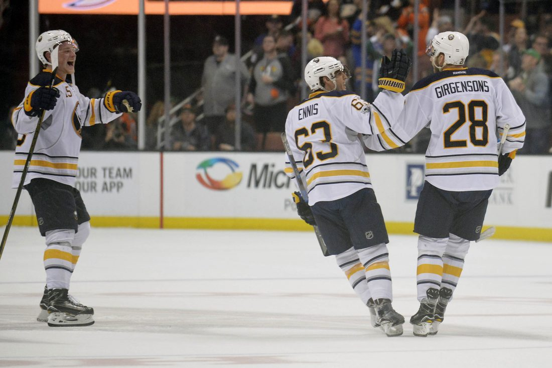Jack Eichel and Tyler Ennis congratulate Zemgus Girgensons on his shootout winning goal  USA Today Sports