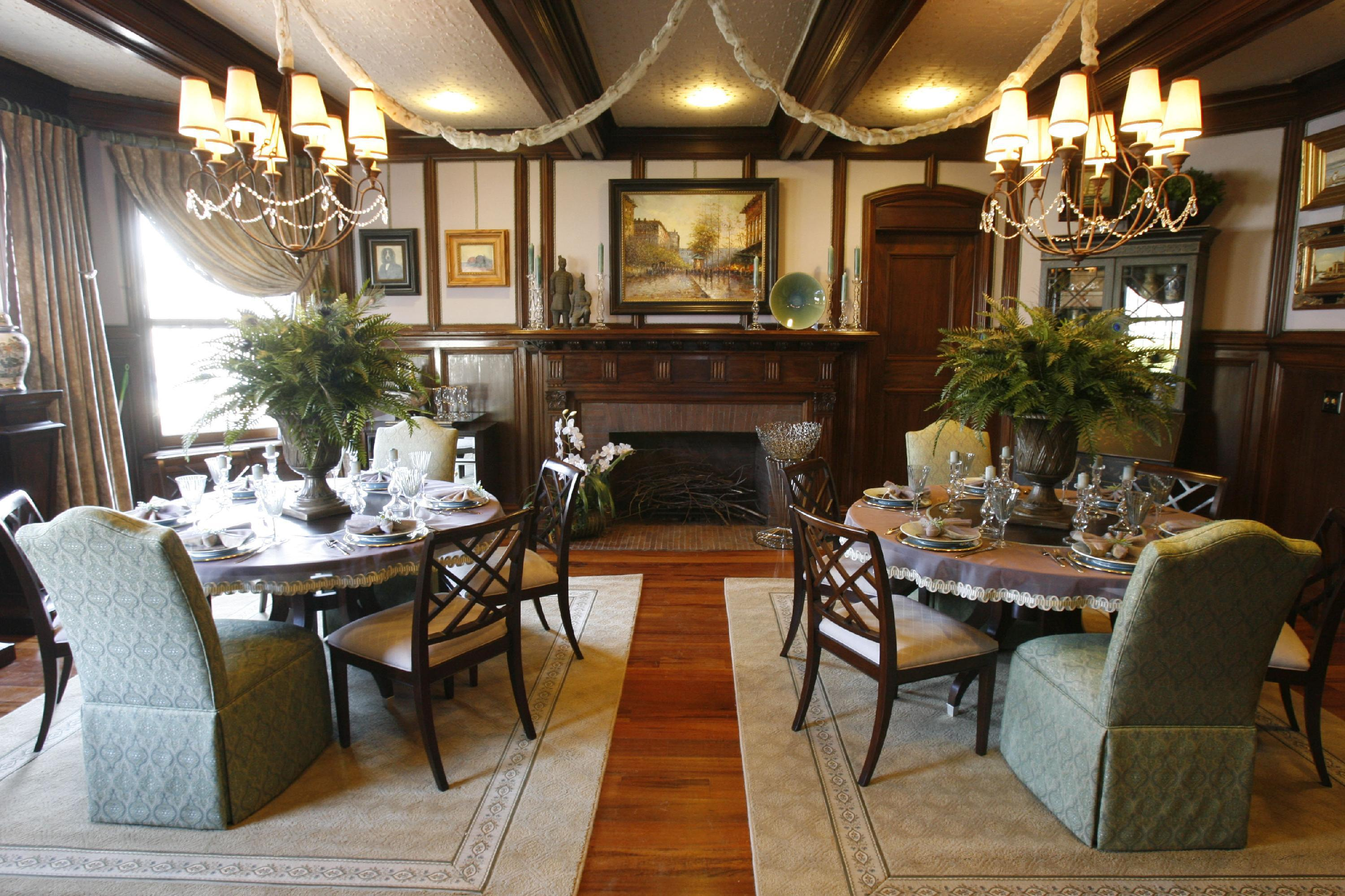 Two round dining tables were found in the dining room of Show House 2007, the Silverthorne Mansion on Delaware Avenue. A team from Ethan Allen designed the room. (News file photo/Robert Kirkham)