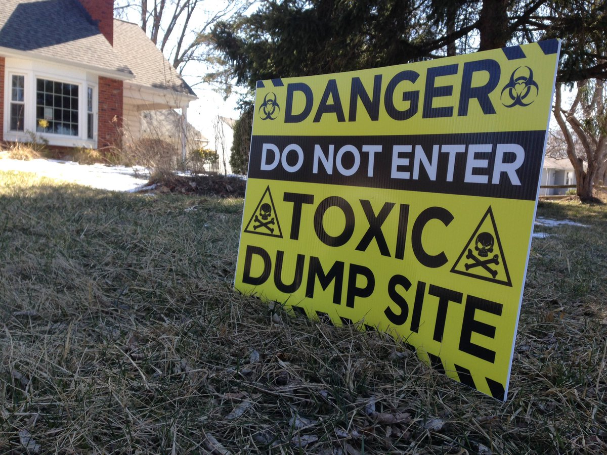 Homeowners around the landfill site warn passers-by of their belief toxins lurk on their properties. (T.J. Pignataro/Buffalo News)