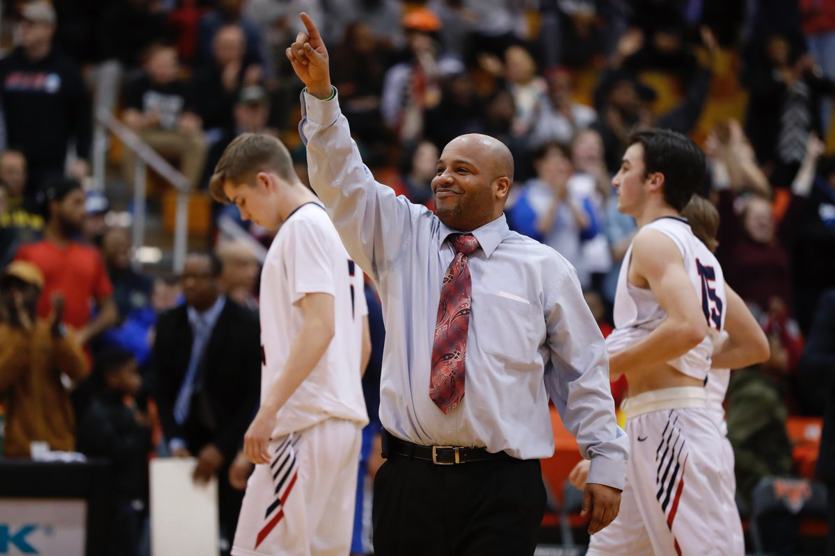 Health Sciences coach Ty Parker signals to start the celebration after the Falcons advanced to Far West Regionals for the first time by winning the overall Section VI Class B title over East Aurora on Tuesday night. (Harry Scull Jr./Buffalo News)