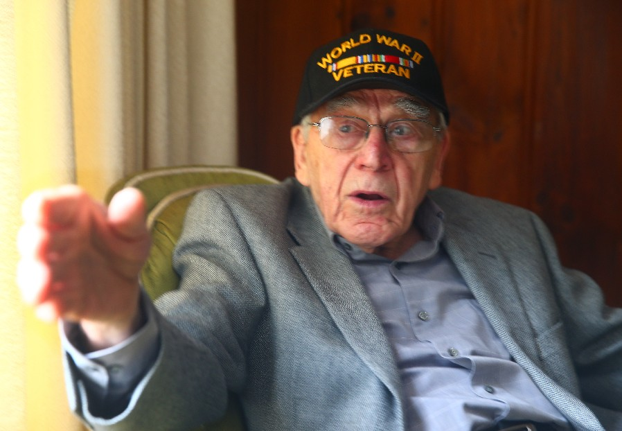 Navy veteran Peter T. Xanthos could actually see the faces of the Japanese kamikaze pilots who flew so close to his ship.  (John Hickey/Buffalo News)
