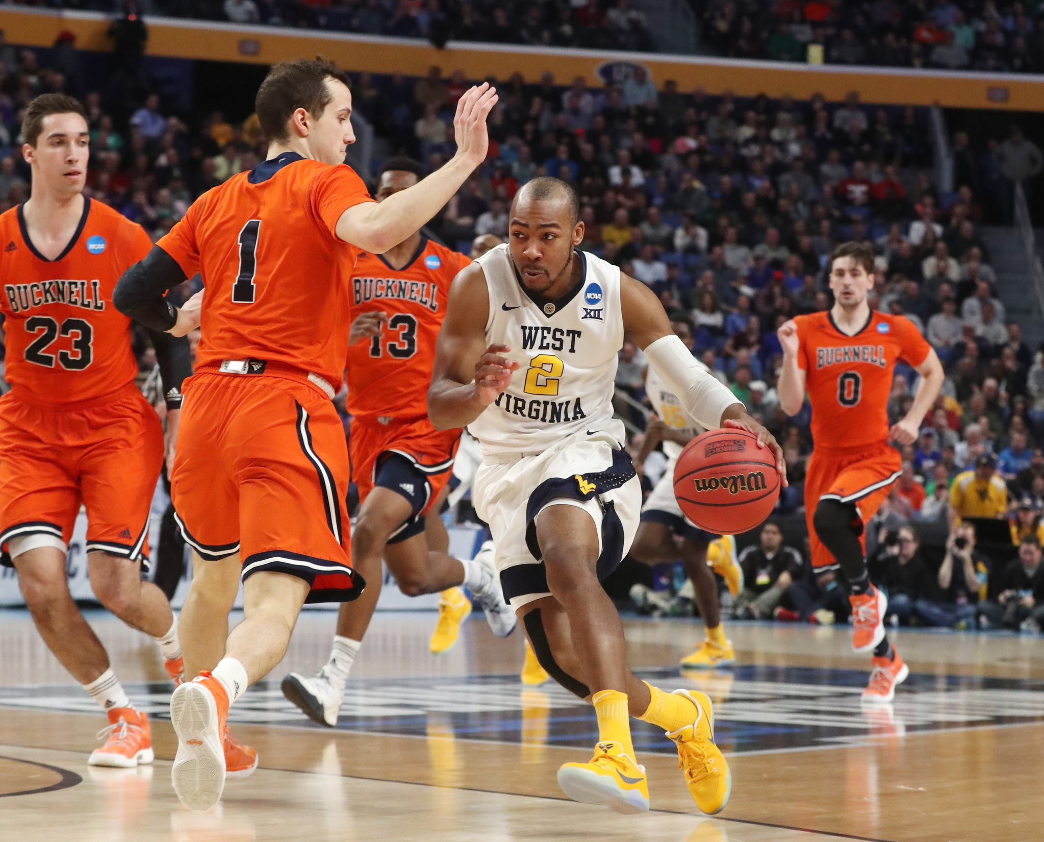 Jevon Carter brings the ball up the floor for West Virginia against Bucknell. (James P. McCoy/Buffalo News)