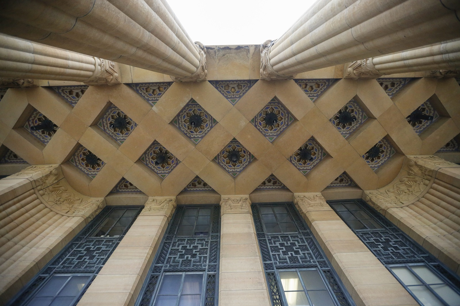 These buildings are gershwin stylish art deco enlivens buffalo the ceiling over the three story stone atrium contained in the pillars on the principle entrance to buffalo metropolis corridor options intricate dailygadgetfo Images