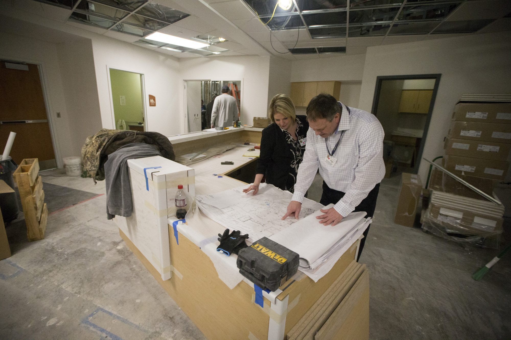 Melissa Rackmill, director of invasive and non invasive cardiology, and Steve Lewis, director of facilities management at the Heart Center of Niagara, at a nurses' station at the new cardiac catheterization lab at Niagara Falls Memorial Medical Center while it was under construction in February. (John Hickey/Buffalo News file photo)
